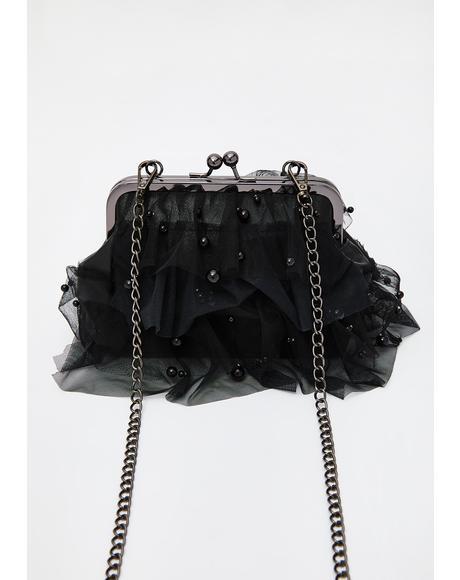 Status Symbol Ruffle Handbag