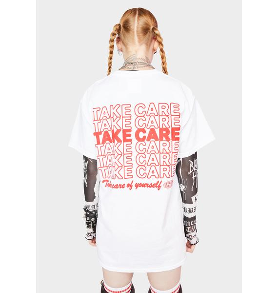 Petals and Peacocks Take Care Graphic Tee