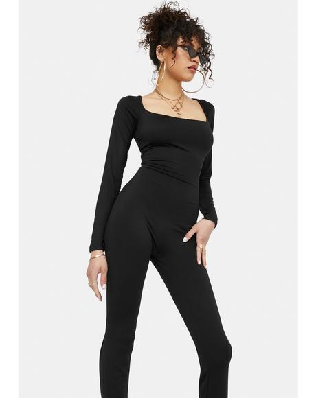 Swept Under Long Sleeve Jumpsuit