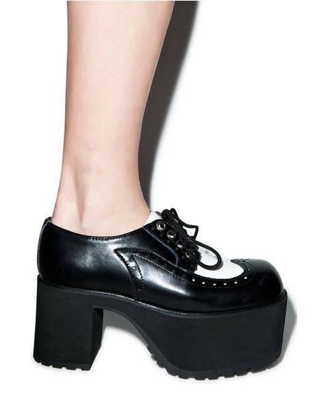 Wingtip Nosebleed Heels