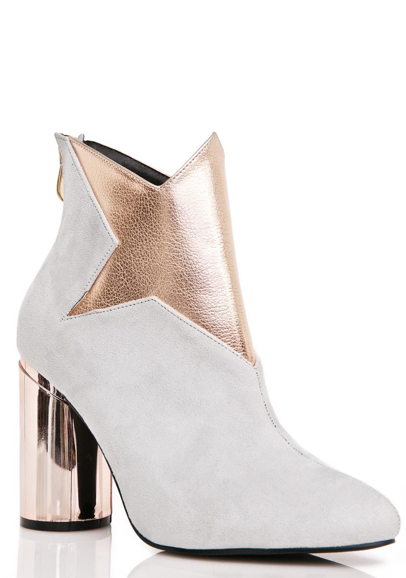 8b9473d71177 Givenchy Star Patch Ankle Boots