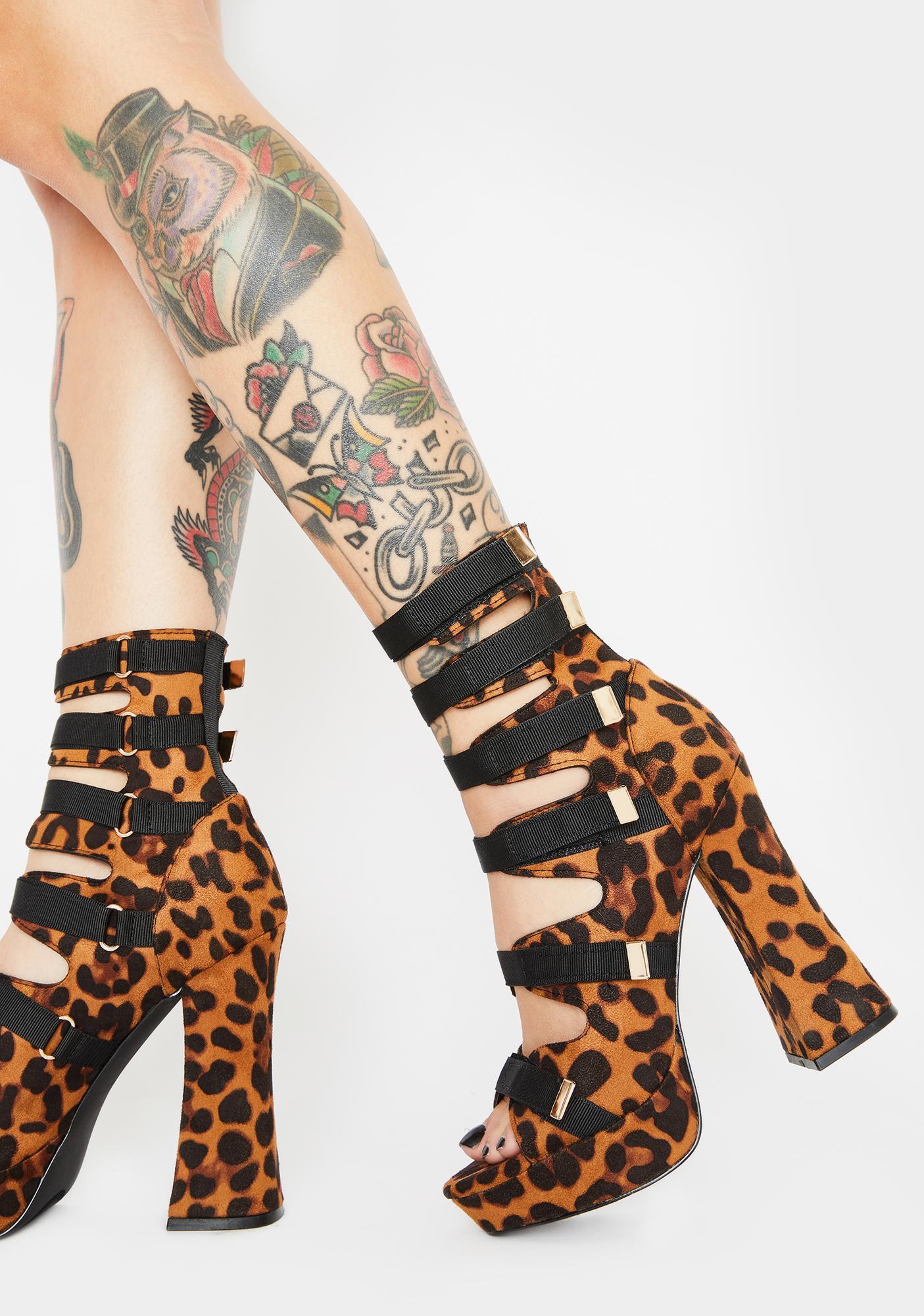 Catty Strap And Scrap Platform Heels