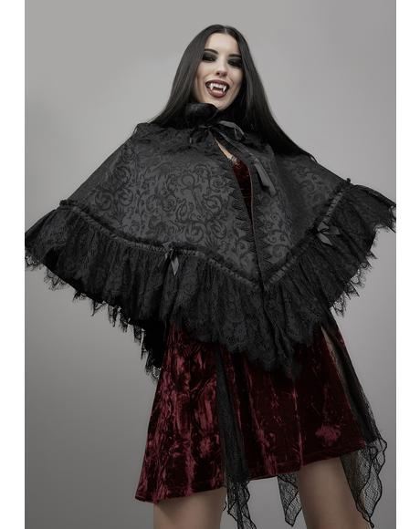 Dark Bidding Brocade Cape