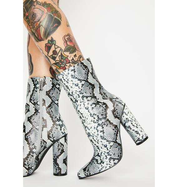 Glow Hazard Snakeskin Boots