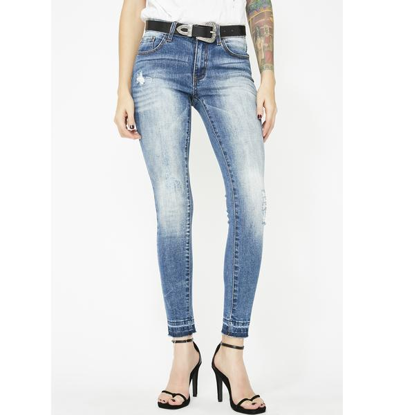 Exposed Mid-Rise Jeans
