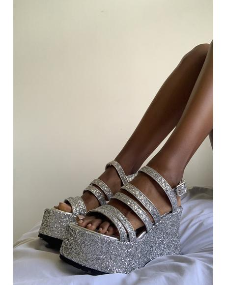 Left In The Dust Platform Sandals