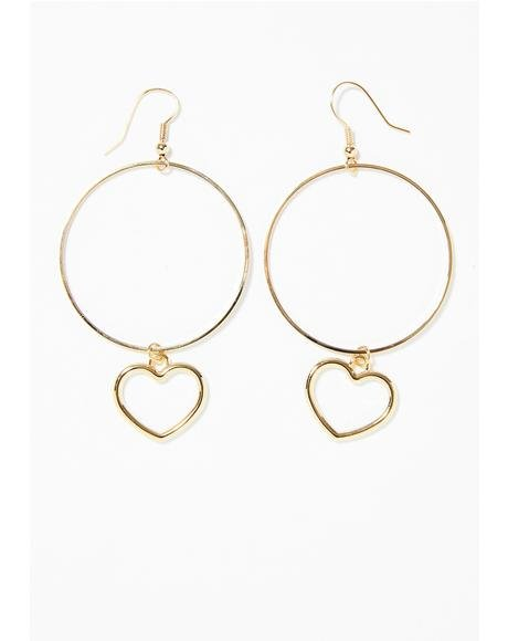 Huge gold hoop earrings