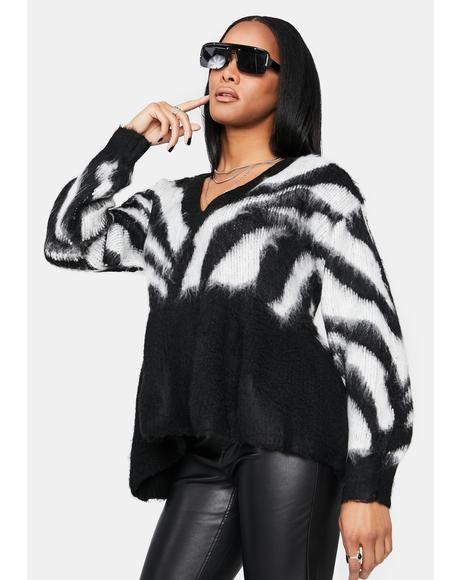 Brief Encounters Zebra Peplum Sweater