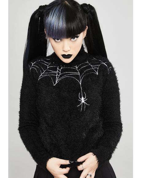 Web Of Deceit Fuzzy Sweater