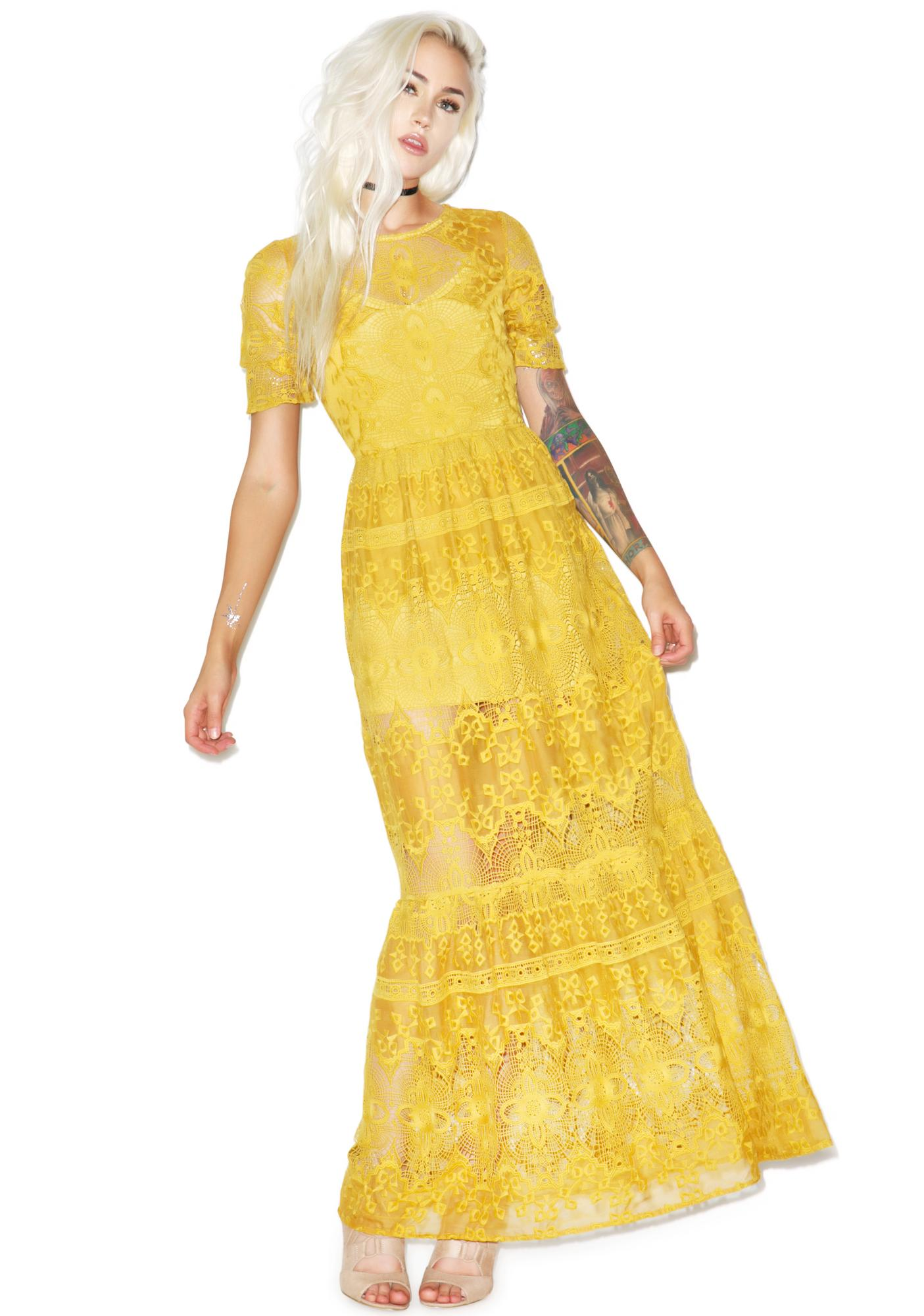 For love and lemons yellow lace dress.