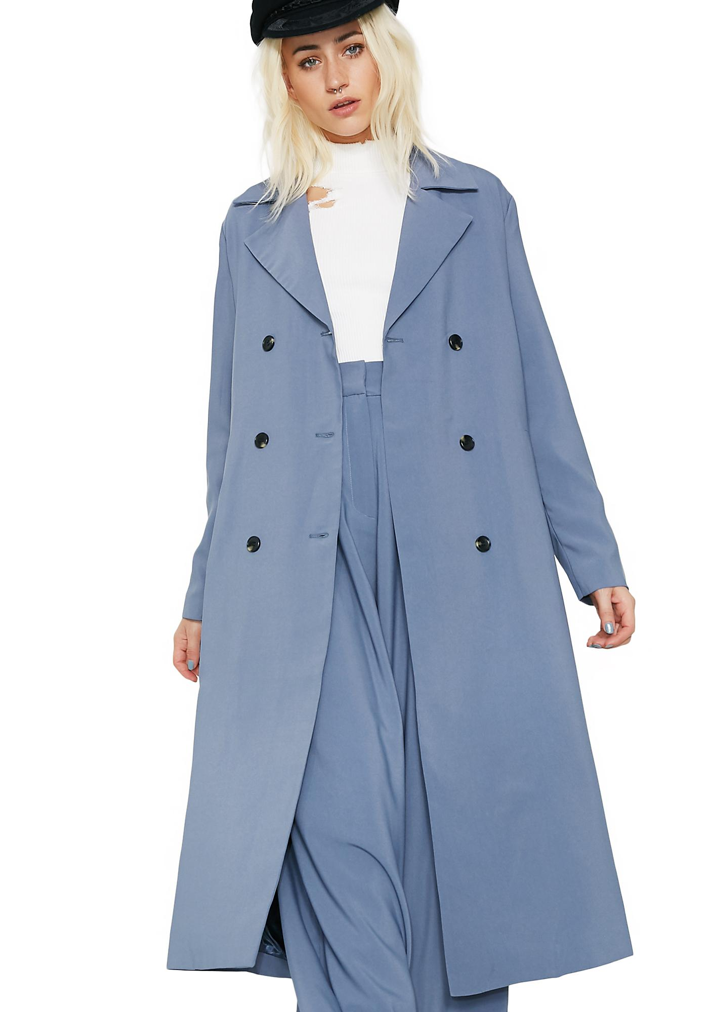 Melania chose a navy blue trench coat with white trim that hit just below her knees for the event. She also donned matching stiletto heels. The trench coat featured a tie .