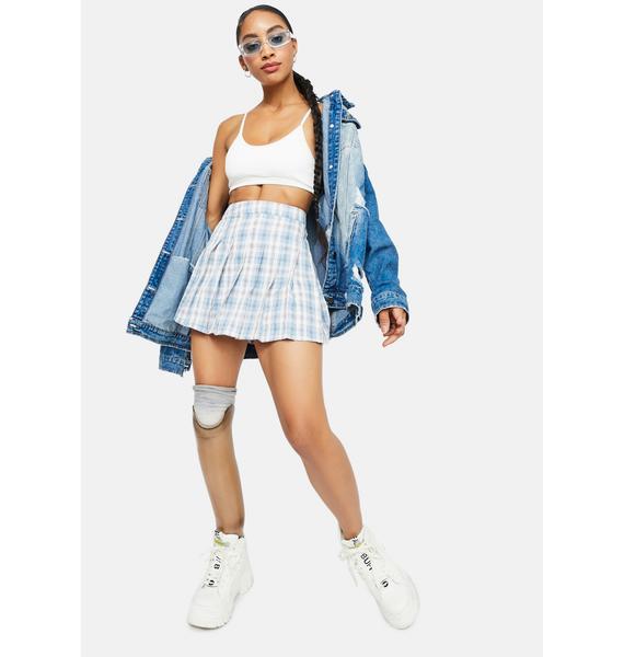 Player in Plaid Mini Skirt