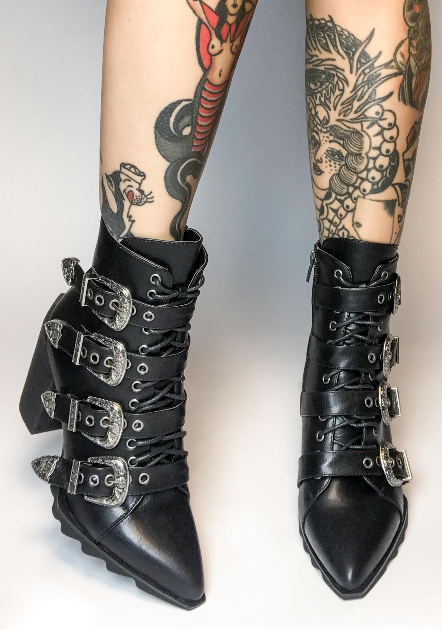 black heeled buckle boots