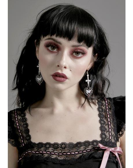Uncanny Collector Cross Earrings