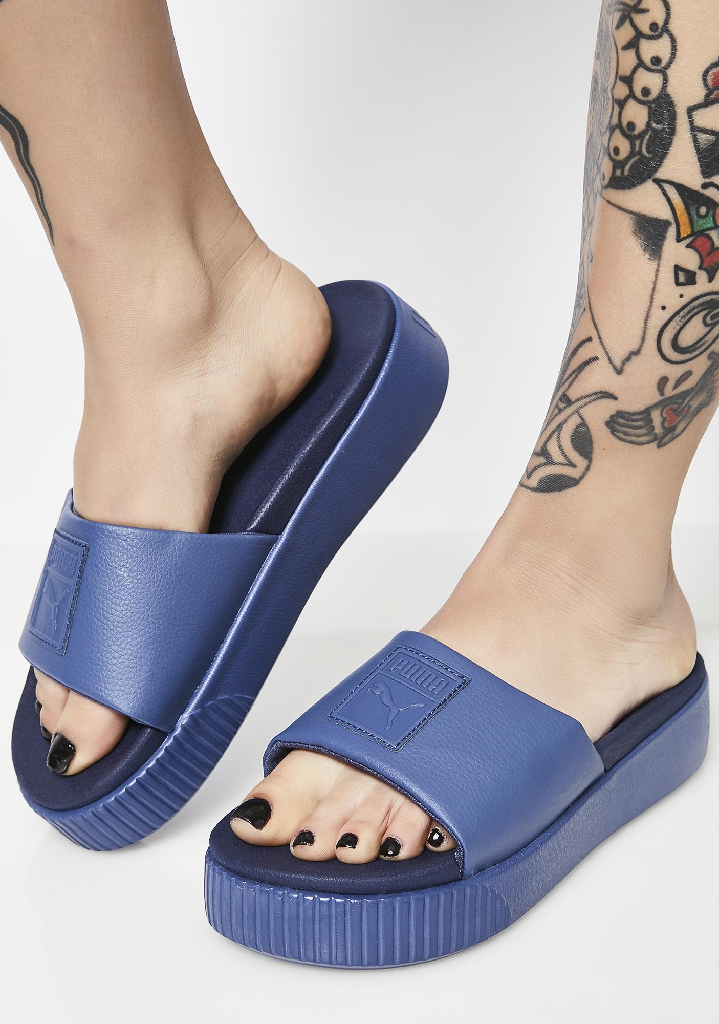 a90b0522374a PUMA Indigo Platform Slide EP Sandals